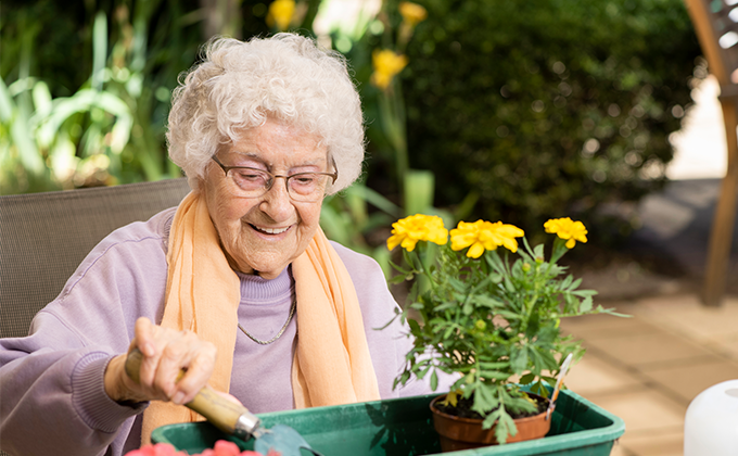 A resident gardening at Onkaparinga Valley Woodside nursing home