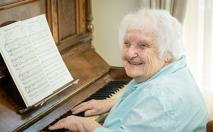 Resident playing piano Onkaparinga Valley Woodside nursing home